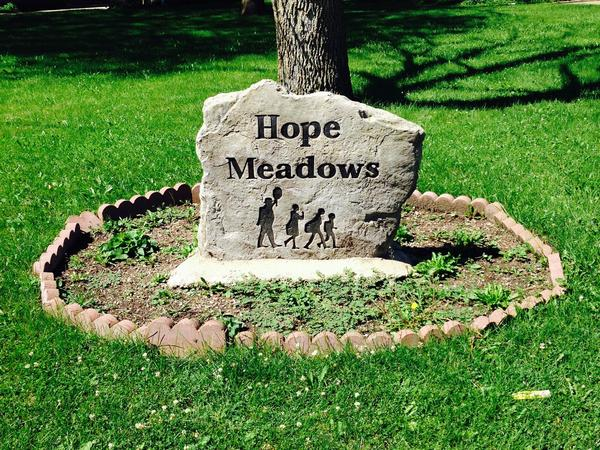 Of the roughly 40 houses currently rented in Hope Meadows in Rantou, Ill., 10 are occupied by families who've adopted children from foster care. The rest are occupied by older adults who volunteer to help them.