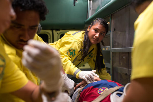 Mimi, 15, volunteers at Comandos de Salvamento. She deals with all kinds of emergencies, extreme violence and people who have been severely injured or killed by the gangs in El Salvador.
