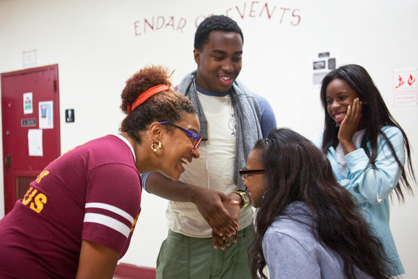 Principal Nikkia Rowe (left) exchanges laughs with students as they head to the cafeteria for lunch.