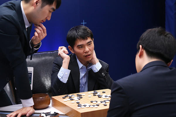 South Korean professional Go player Lee Sedol reviews the match with other professional Go players after the fourth match against Google's artificial intelligence program, AlphaGo.