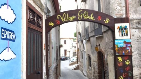 Riace's medieval old town is a warren of winding cobblestone streets atop a hill. Migrants have revitalized the shopping district.