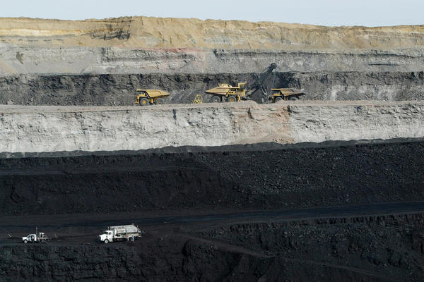 A view of two coal seams and coal hauling trucks being loaded in the Buckskin Coal Mine, 12 miles north of Gillette, Wyo.