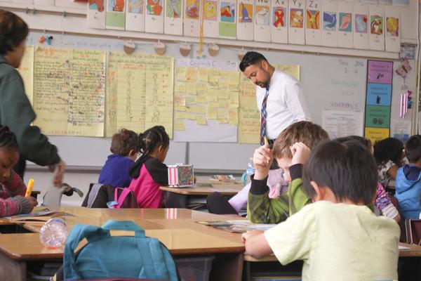 Principal Daniel Rolleri helps out in class at Sacramento's Oak Ridge Elementary.