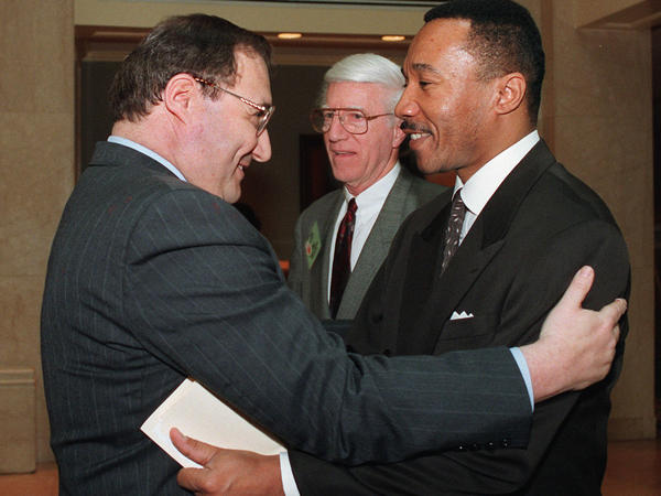 """NAACP President and Chief Executive Officer Kweisi Mfume (right) embraces Anti-Defamation League National Director Abe Foxman in Washington prior to an April 22, 1996, discussion titled """"Black/Jewish Relations and the Future of the East Civil Rights Movement."""" Foxman led the ADL from 1987 to 2015."""