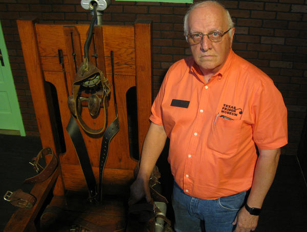 "Texas Prison Museum Director Jim Willett with the retired electric chair, ""Old Sparky,"" the most popular exhibit in his museum."