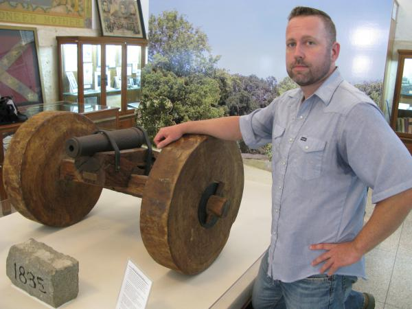 "Local journalist Erik McCowan, standing in the Gonzales Memorial Museum, thinks people should know the history behind the phrase, ""Come and take it!"""