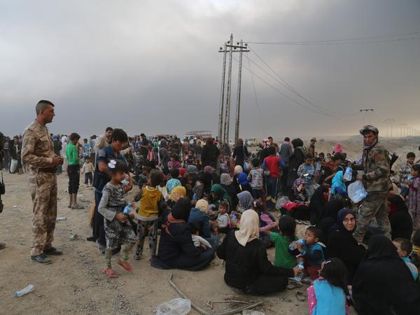 As the operation to retake Mosul continues, Iraqis fleeing ISIS-controlled areas of the city arrived Tuesday at the nearby town of al-Qayyarah, secured by the Iraqi army.