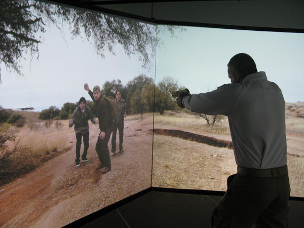 In order to reduce shootings, all Border Patrol agents are now required to train in a simulated environment complete with immigrants threatening rocks. Agent Aaron Sims trains on the simulator at the CBP National Training Center in Harper's Ferry, W.V.