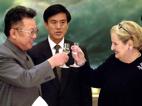 Then-Secretary of State Madeleine Albright and North Korean leader Kim Jong Il toast in Pyongyang on Oct. 24, 2000. The U.S. and North Korea signed an agreement six years earlier to curb North Korea's nuclear activities in exchange for aid, but it collapsed in 2002, during the Bush administration.