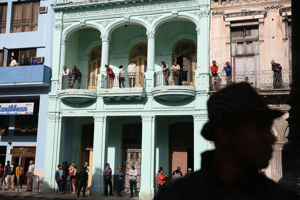 People wait to see President Obama on his way to make a televised address to the Cuban people in Havana on March 22. President Obama's opening to Cuba was carried out largely by executive orders that could be reversed when Donald Trump enters the White House.