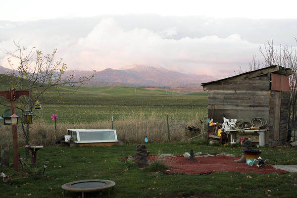Dawn Tachell's yard in Syringa Mobile Home Park looks out to mountains near Moscow, Idaho. She bought the home 13 years ago, fulfilling her dream to own her home.