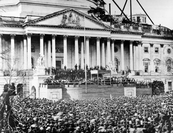 President Abraham Lincoln stands under cover at center of Capitol steps during his inauguration in Washington, D.C., on March 4, 1861.