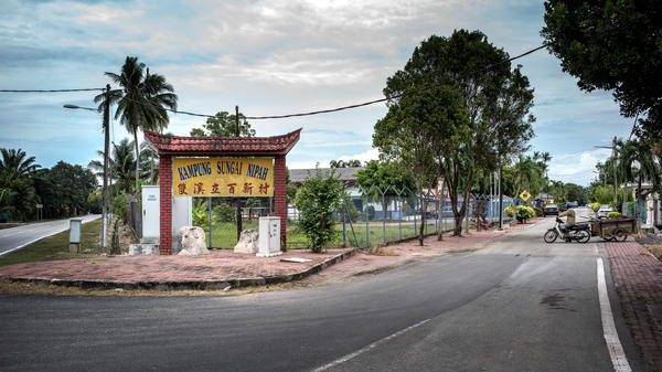 """The entrance to the town of Nipah, which the Malaysian government quarantined in 1999 to try to stop the spread of a new deadly virus. """"It was like a ghost town,"""" says Thomas Wong, a former pig farmer in Nipah. """"No one could come in. No one could leave."""""""