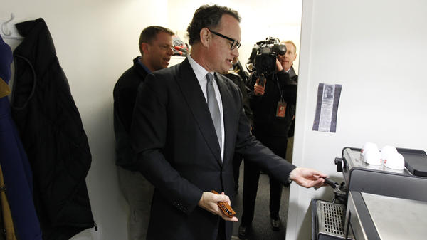 Tom Hanks visits his old espresso machine during a visit to the White House March 11, 2010.