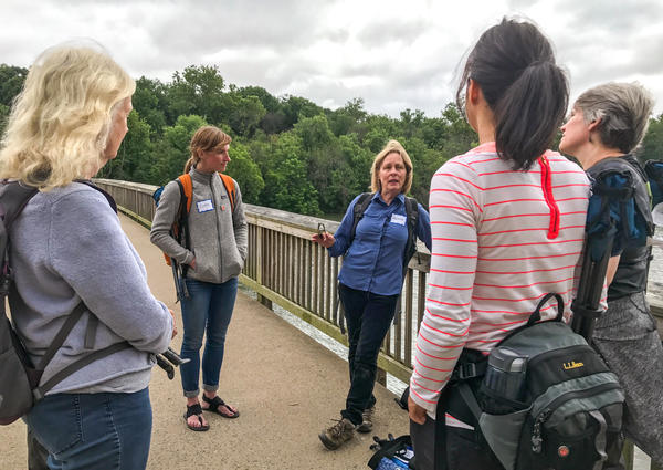 Melanie Chouckas-Bradley leads a group of five women in a forest bathing excursion. She is certified as a forest therapy guide through the Association of Nature & Forest Therapy.