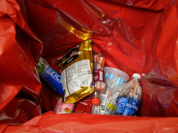 Alaska volunteers collect used syringes stored in puncture-proof plastic drink containers.