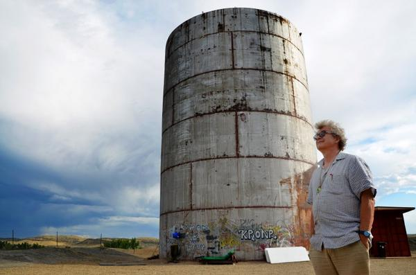 Composer, sound artist and longtime supporter Bruce Odland stands outside The Tank on the outskirts of Rangely, Colo. (Brad Turner/CPR)
