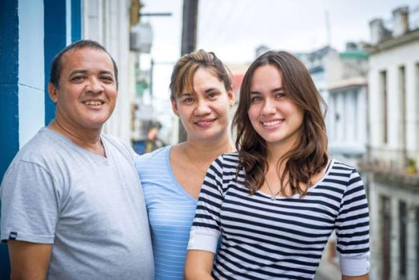 CUBAN LIVELIHOODS: Carla Leon (right) with her parents Jorge Leon (left) and Nardy Mirabent at the home they rent in Havana.