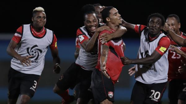 Trinidad and Tobago's Alvin Jones (17) celebrates after scoring against the U.S. Tuesday, in a game that served as revenge for his team's 1989 loss to the Americans. The U.S. men are eliminated from the 2018 World Cup.