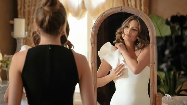 Elizabeth Gillies (back to camera) plays Fallon and Nathalie Kelley plays Cristal in the CW remake of the nighttime soap that put Joan Collins in a pool: <em>Dynasty</em>.