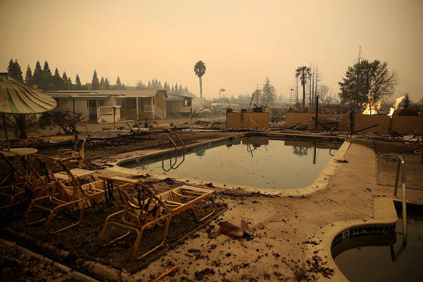 Burned lawn chairs sit next to the swimming pool at the Journey's End Mobile Home Park in Santa Rosa, California. Wildfires that have burned tens of thousands of acres and destroyed hundreds of homes and businesses in several Northern California counties.