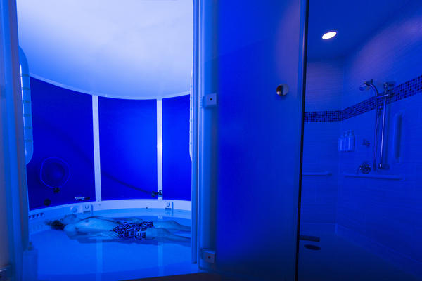 A staff member demonstrates the float tank used for studies at the Laureate Institute for Brain Research in Tulsa, Okla.