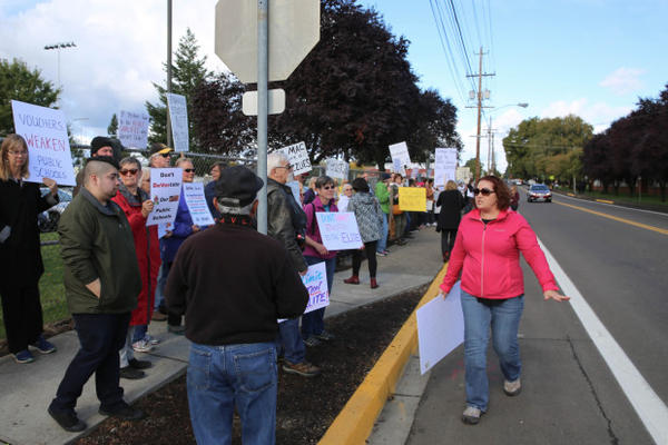 <p>Protesters line the sidewalk near McMinnville High School, where U.S. Education Secretary Betsy DeVos visited Wednesday, Oct. 11, 2017.</p>