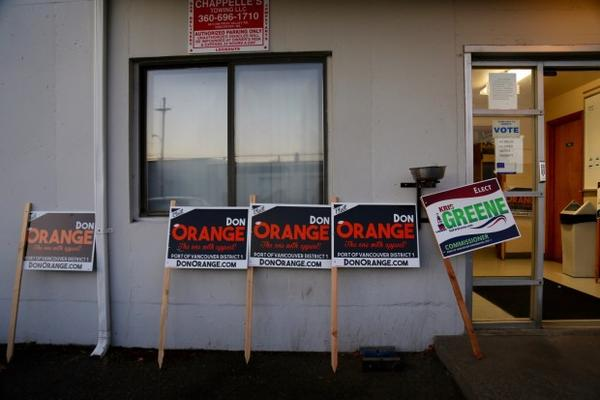 <p>Campaign signs for Port of Vancouver Commissioner race outside the ILWU building in downtown Vancouver.</p>