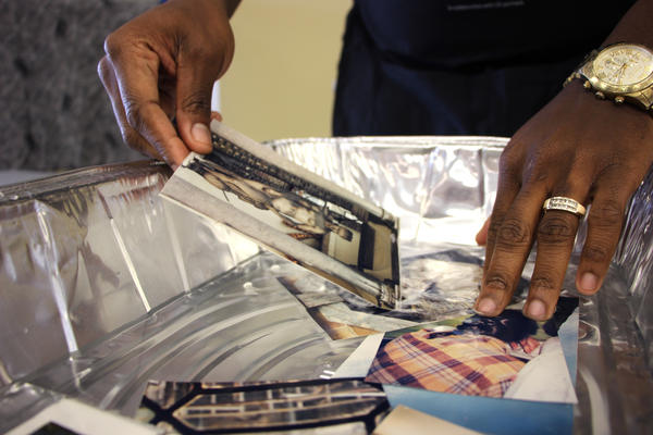 Museum curator Teddy Reeves demonstrates a method of salvaging damaged photos at a workshop in Beaumont, Texas.