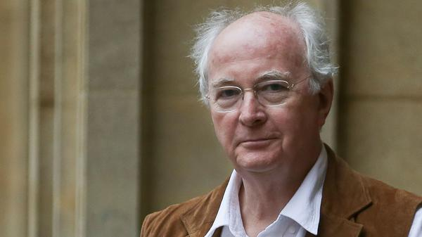 Author Philip Pullman — pictured at the Bodleian Libraries in Oxford, England — is resurrecting his famed fantasy world for a new trilogy.