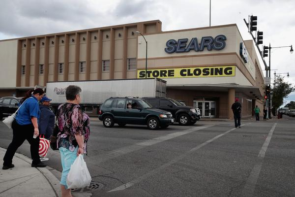 A sign announcing the store will be closing hangs above a Sears store on Aug. 24, 2017 in Chicago. (Scott Olson/Getty Images)