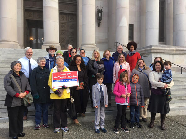 Members of Washington's Paramount Duty coalition pose for a photo outside the Washington Supreme Court before a court hearing on the McCleary school funding case.