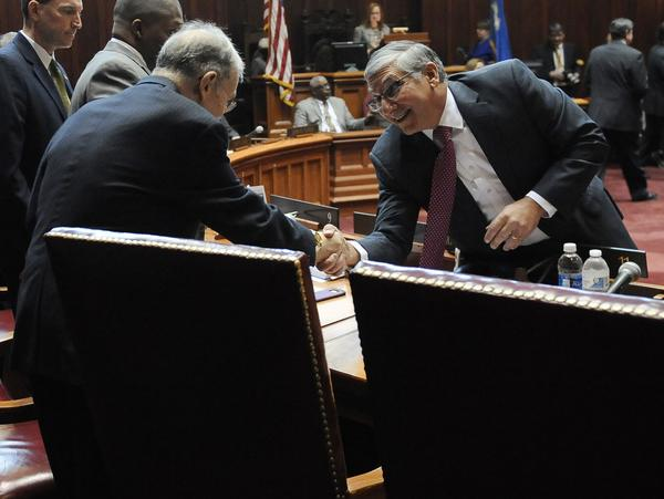 Senate Republican President Pro Tempore Len Fasano, R-North Haven, greets Senate President Pro Tempore Martin M. Looney, D-New Haven, right, during the opening session at the state Capitol in January in Hartford, Conn.