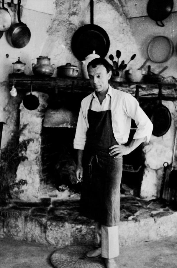 Richard Olney in his kitchen in France's Provence. The artist and cookbook author introduced Americans to the way the French plan a menu.