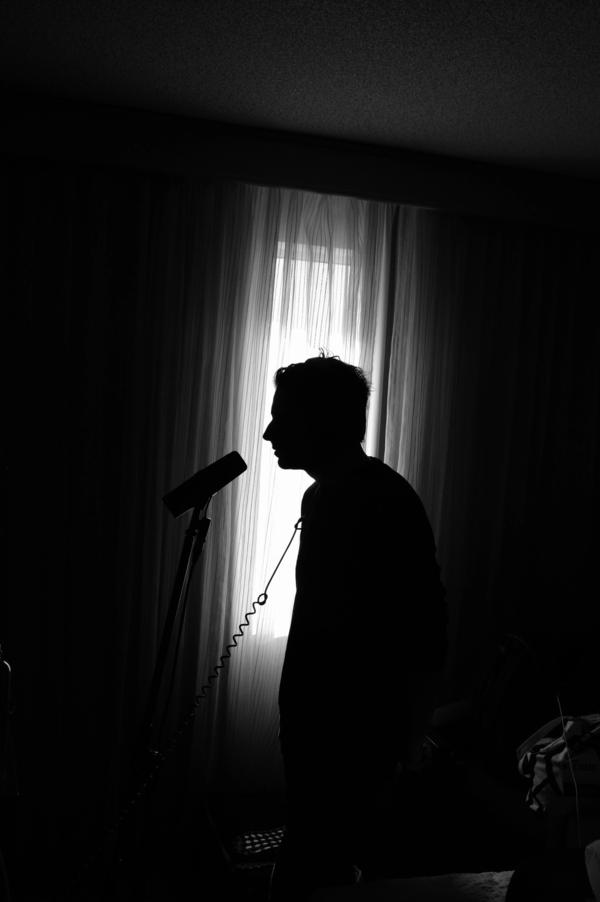 Tracking some vocals on a demo in Montreal, Quebec. We love setting up mobile studios in our hotel rooms.