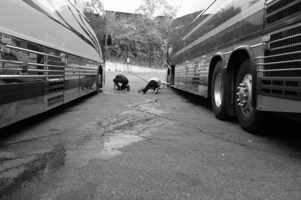 This photo was taken in the parking lot of our first gig with Phoenix in Columbus, Ohio. We turned the parking lot into a soccer field and our ball got stuck under the band's bus. Sterling and Sam fetched it out with a long broom.