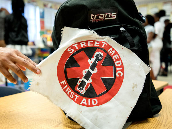 A street medic patch marks a first aid kit at a UMedics workshop in Chicago's Bronzeville neighborhood. The group trains everyday people to care for shooting victims, control a chaotic scene and talk to cops and paramedics.