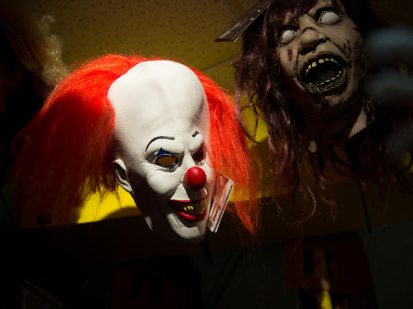 A Pennywise mask from the movie <em>It.</em>