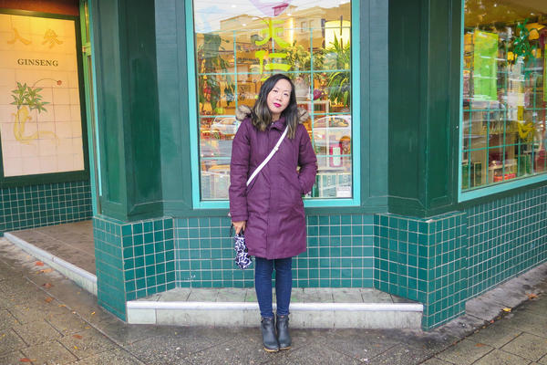 Author Jen Sookfong Lee in front of the Vancouver tea shop where her grandfather's barber shop once stood.