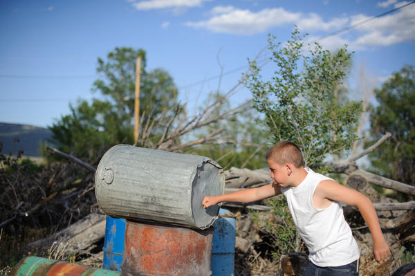 Vinny punches a trashcan behind his aunt's home in northern New Mexico. Juvenile Court ordered that he live with his paternal aunt after his release from juvenile detention. He was incarcerated at age 13 for stabbing his mother's assailant.