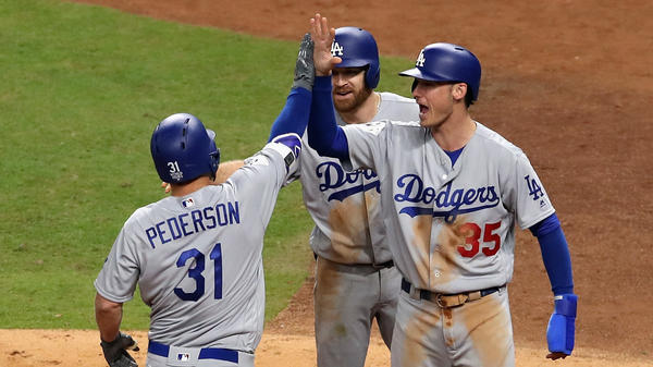 Joc Pederson of the Los Angeles Dodgers celebrates hitting a three-run home run in the ninth inning.