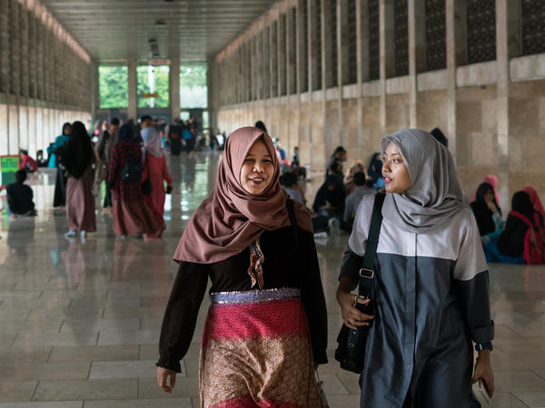 Women walk through Istiqlal Mosque, on a recent Sunday, in Jakarta, Indonesia. The fourth-largest country in the world is also one of the most diverse. Indonesia is a democracy, with a larger Muslim population than the entire Arab world combined.