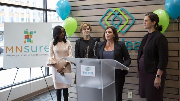 Minnesota's Human Services Commissioner Emily Piper, right, and Minneapolis Mayor Betsy Hodges, second from left, joined MNsure CEO Allison O'Toole, and Hodan Guled, left, at a recent enrollment launch event in Minneapolis.