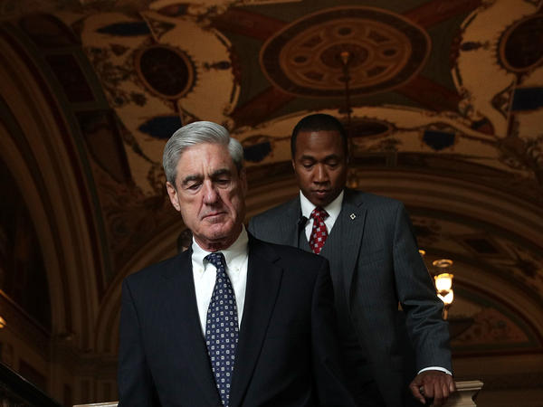 Special counsel Robert Mueller (left) arrives at the U.S. Capitol for closed meeting with members of the Senate Judiciary Committee on June 21 in Washington, D.C.