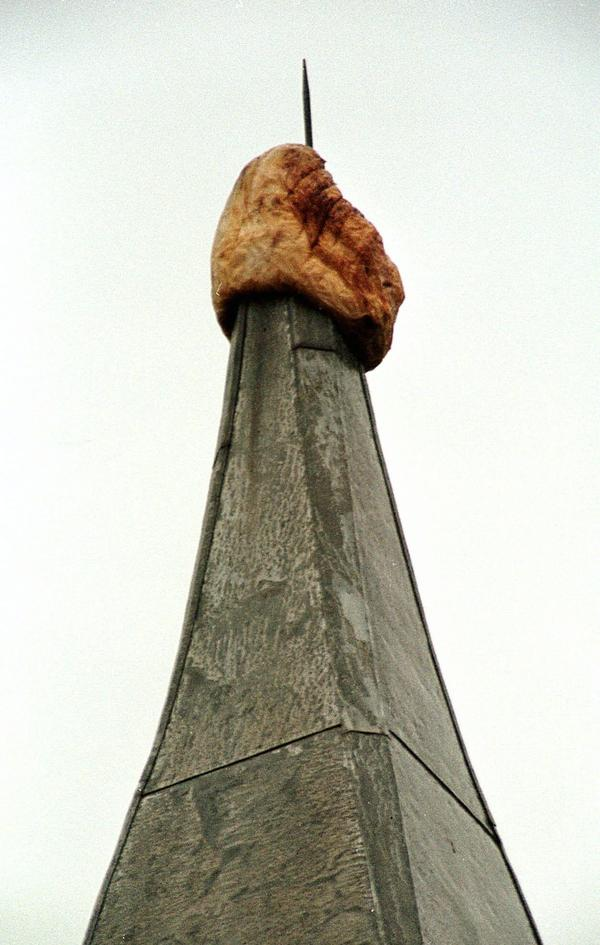 A highly weathered pumpkin sits atop the 173-foot tall McGraw Tower at Cornell University on Feb. 20, 1998, in Ithaca, N.Y. The pumpkin, estimated to weigh some 50 pounds originally was put up by unknown persons on Oct. 8, 1997, and surprised the campus by lasting through the winter.