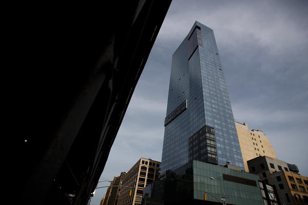 Trump SoHo Hotel Condominium looms over its neighborhood of Hudson Square in lower Manhattan.