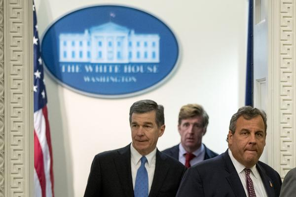 From left, North Carolina Gov. Roy Cooper, former Rep. Patrick Kennedy, R.I., and Chairman, New Jersey Gov. Chris Christie arrive for a President's Commission on Combating Drug Addiction and the Opioid Crisis meeting in the Eisenhower Executive Office Building on the White House Complex, Wednesday, Sept. 27, 2017, in Washington. (Andrew Harnik/AP)