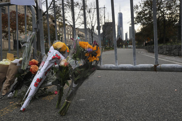 A makeshift memorial stands on a bike path in Lower Manhattan on Wednesday. Eight people on the path were killed in a truck attack Tuesday.