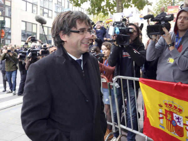 Sacked Catalan President Carles Puigdemont arrives for a news conference in Brussels on Tuesday.