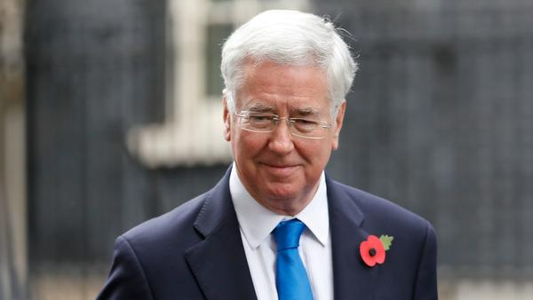 Michael Fallon leaves the prime minister's residence in London on Tuesday.
